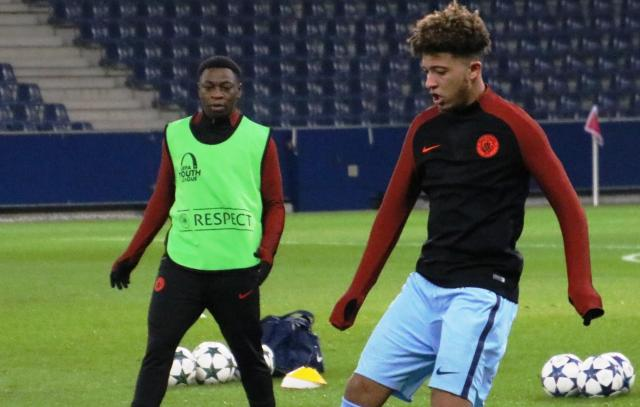 Jadon Sancho (right) while playing for Manchester City.